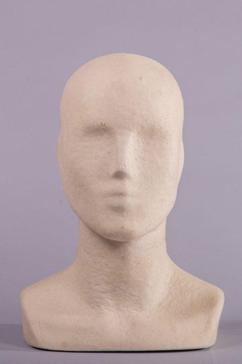 espositore testa uomo carta pesta