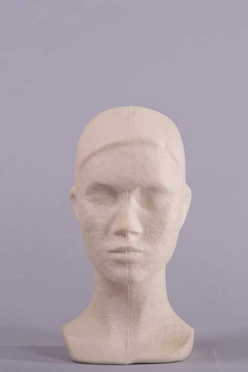 espositore testa donna carta pesta